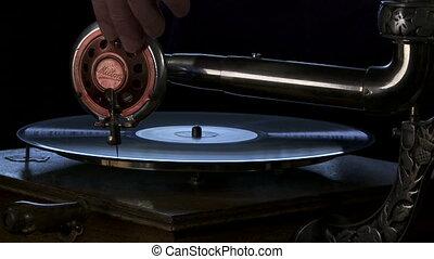 Vintage phonograph player - Medium close shot of an antique...