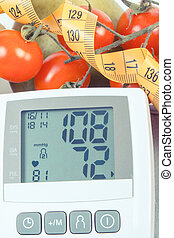 Vintage photo, Blood pressure monitor with result of measurement, fruits with vegetables and centimeter, healthy lifestyle