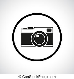 Vintage photo camera in a circle. Black flat icon with...