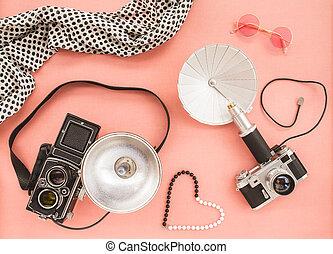 Vintage photo cameras on pink background