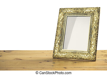 Vintage photo frame on wooden table