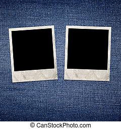 Vintage photo frames on blue jeans background