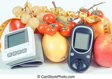 Vintage photo, Glucometer, blood pressure monitor, fruits with vegetables and centimeter, healthy lifestyle