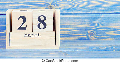 Vintage photo, March 28th. Date of 28 March on wooden cube calendar
