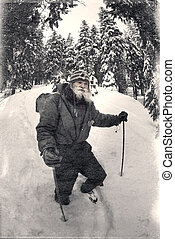 Vintage photo of a mountaineer in winter ascent