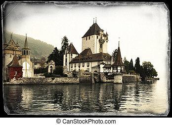 Vintage photo of Oberhofen Castle on the lake of Thun, Switzerland