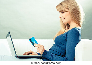 Vintage photo, Woman with credit card paying over internet for online shopping