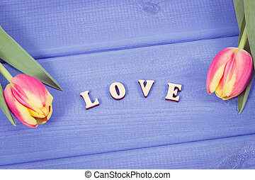 Vintage photo. Word love and fresh tulips for different occasions