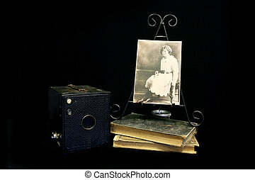 Vintage Photograph Next to an Old Antique Camera - Vintage...