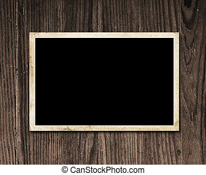 Vintage blank photo on wooden table with copy space.