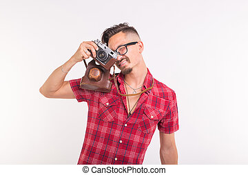 Vintage, photographer and people concept - handsome man with retro camera over white background