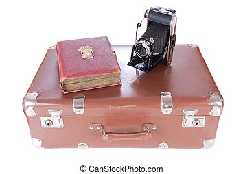 Vintage photography camera with old photoalbum