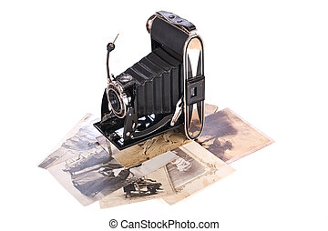 Vintage photography camera with old photos