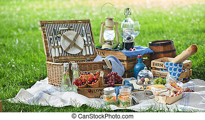 Vintage picnic hamper with lunch in a park