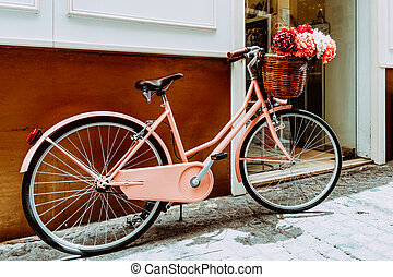 Vintage Pink Bicycle With A Decorative Basket Of Flowers Parking