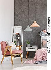 Vintage pink chair in bedroom