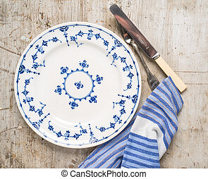 Vintage plate with wooden background