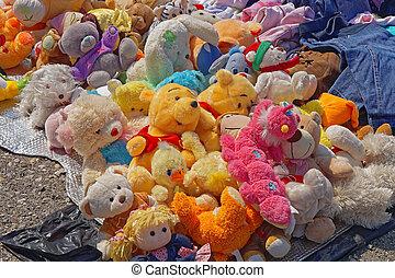 Big bunch of used old vintage plush toys at flea market
