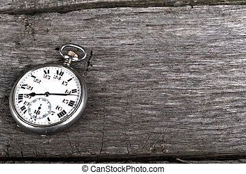 vintage pocked watch on old wood