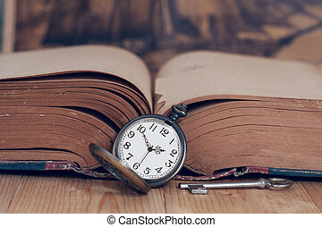Vintage pocket watch on old books.