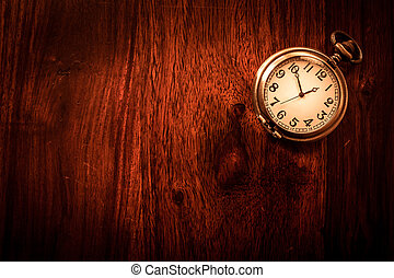 Vintage pocket watch on solid wood