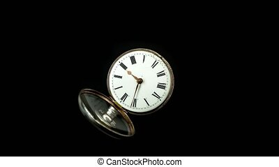 Vintage pocket watch rotate arrows go. Black background....