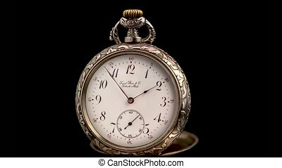 Vintage pocket watch rotate arrows go. Black background....