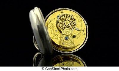 Vintage pocket watch rotate. Black background. Sound -...
