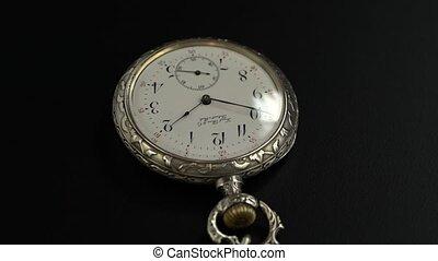 Vintage pocket watch rotate. Black background - Vintage...