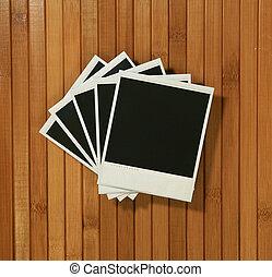 Vintage Polaroid Frames on Bamboo Background