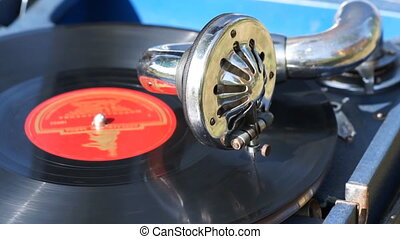 Vintage portable gramophone, common and close-up views