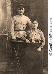 Antique family photo of long ago passed away relatives - circa 1915, Russia.