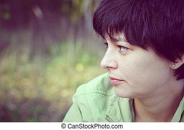 vintage portrait of a beautiful pensive woman