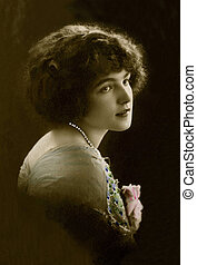 Vintage portrait of a young girl. The shot was taken around 1914 year.