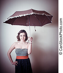 vintage portrait of young woman with umbrella