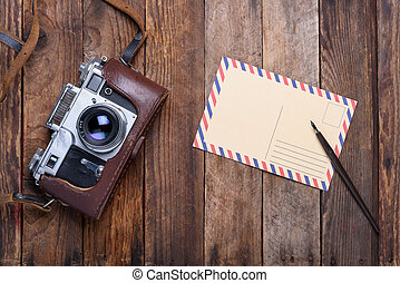 Vintage post card and retro camera