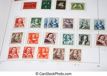 Vintage postage stamps from the Netherlands in an album