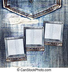 Vintage postcard with slides on old jeans background