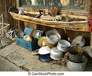 vintage pots and pans outside an old barn