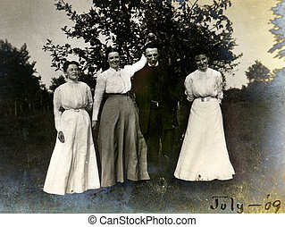 Vintage Preacher - Three playful women pose with a solemn...