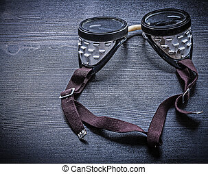 vintage protective goggles on wood board
