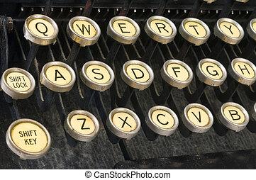 closeup of a vintage keyboard, showing QWERTY keys