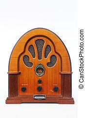 A vintage radio over white background.