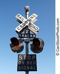 Vintage railroad signal warns motorists to stop.