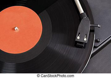 Vintage record player with spinning vinyl. Motion blur...