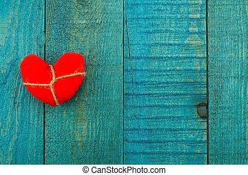 vintage red heart on old blue wooden background