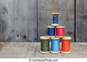 Vintage reels of thread and needle