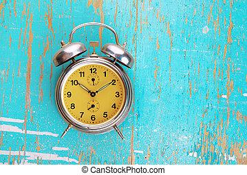 Vintage Retro Alarm Clock on Rustic Blue Background
