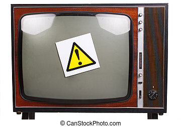 Vintage retro black and white TV with yellow attention sign