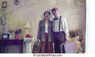 Vintage retro fashion Asian senior couple travel luxury trip after retirement life
